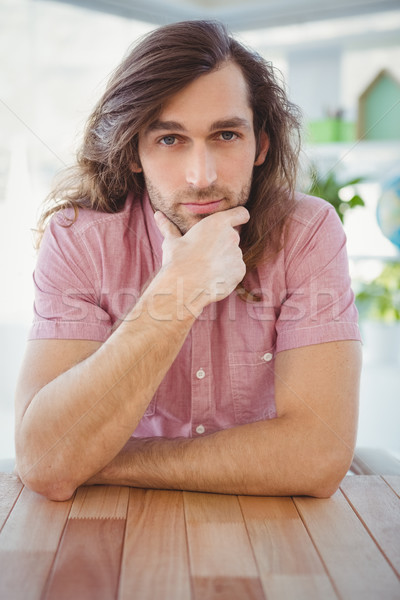 Portrait of confident hipster with hand on chin Stock photo © wavebreak_media