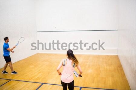 Competitivo Pareja jugando calabacín junto tribunal Foto stock © wavebreak_media