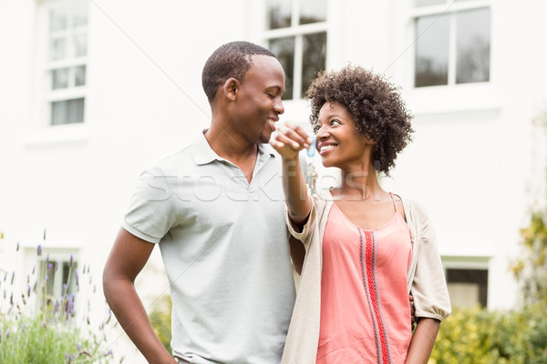 Smiling couple holding keys Stock photo © wavebreak_media