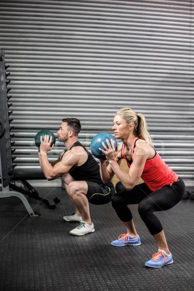 Couple doing ball exercise Stock photo © wavebreak_media