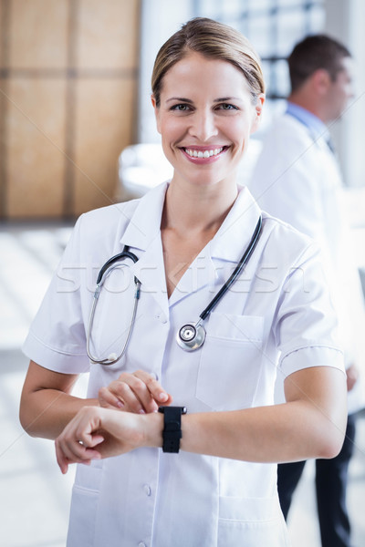 Nurse checking her smart watch Stock photo © wavebreak_media