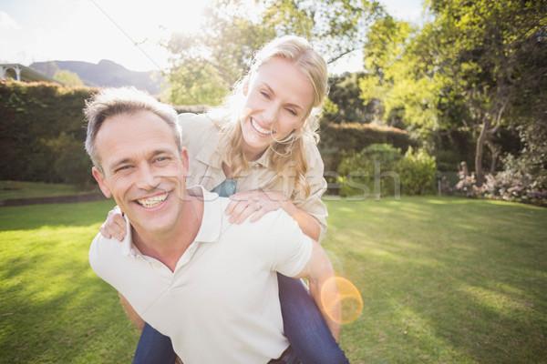 Husband giving piggy back to wife Stock photo © wavebreak_media