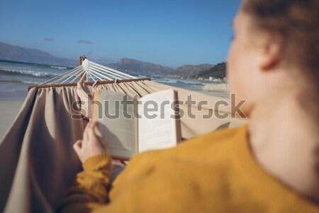 Woman having wine in porch Stock photo © wavebreak_media