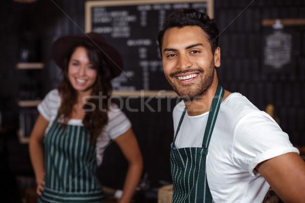 Smiling baristas looking at the camera Stock photo © wavebreak_media