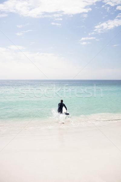 Szörfös fut tenger szörfdeszka napos idő égbolt Stock fotó © wavebreak_media