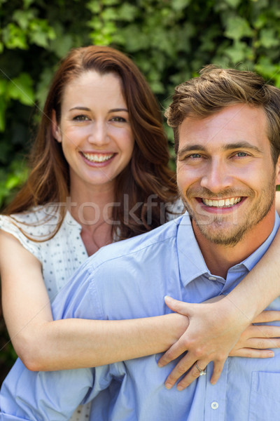 Young woman hugging man at front yard Stock photo © wavebreak_media