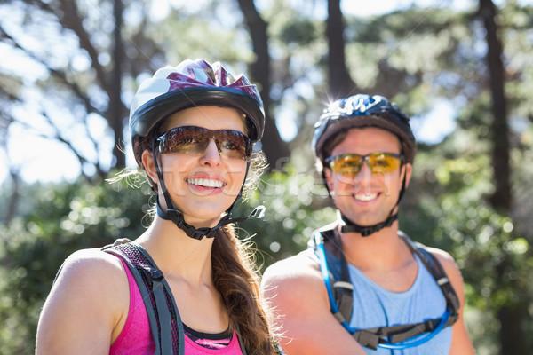 Retrato sorridente casal capacetes Foto stock © wavebreak_media
