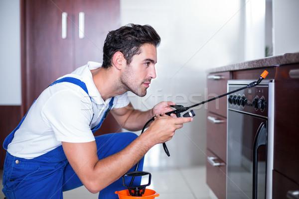 Uomo forno cucina home lavoro sicurezza Foto d'archivio © wavebreak_media