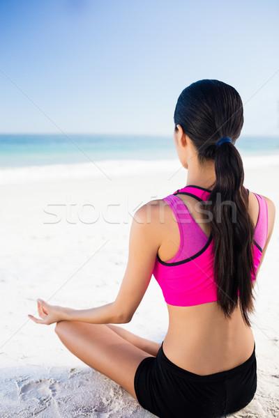 Woman doing yoga on the beach Stock photo © wavebreak_media