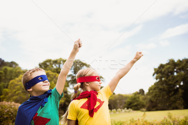 Portrait of children with superhero dress posing with raised arm Stock photo © wavebreak_media