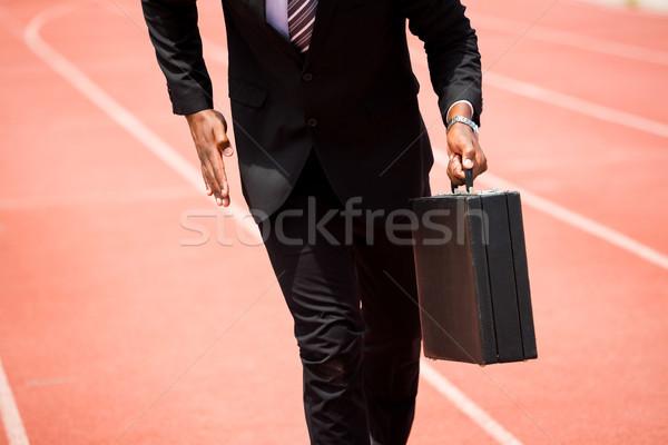 Középső rész üzletember fut útvonal aktatáska sport Stock fotó © wavebreak_media