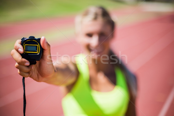 Female athlete showing stop watch Stock photo © wavebreak_media