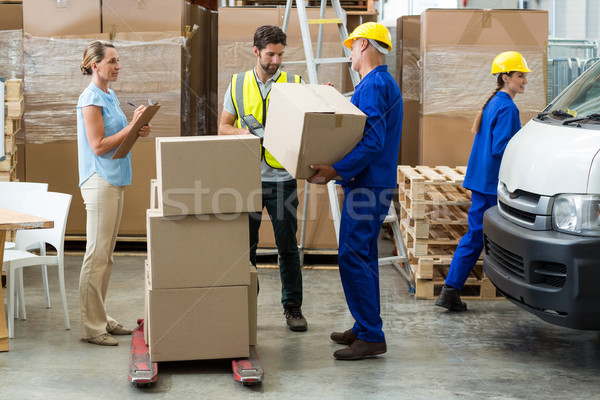 Workers carrying boxes Stock photo © wavebreak_media