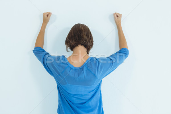 Rear view of woman standing against wall Stock photo © wavebreak_media