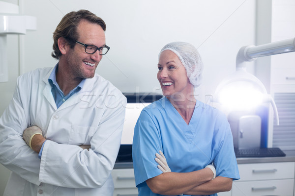 Smiling dentist and dental assistant standing with arms crossed Stock photo © wavebreak_media