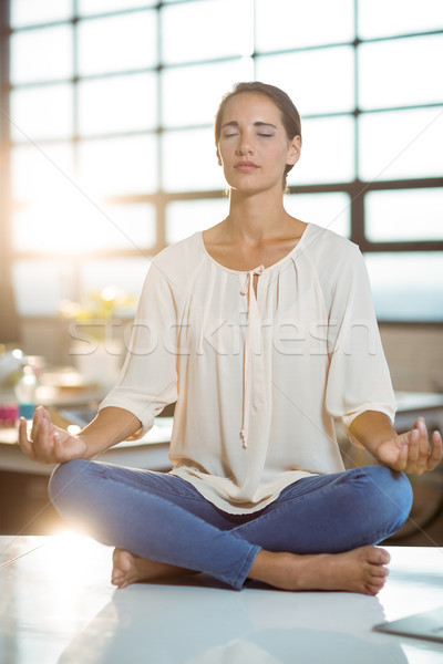 Business executive performing yoga Stock photo © wavebreak_media