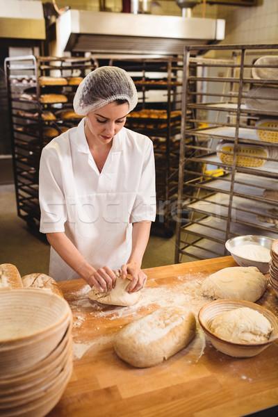 Female baker kneading a dough Stock photo © wavebreak_media