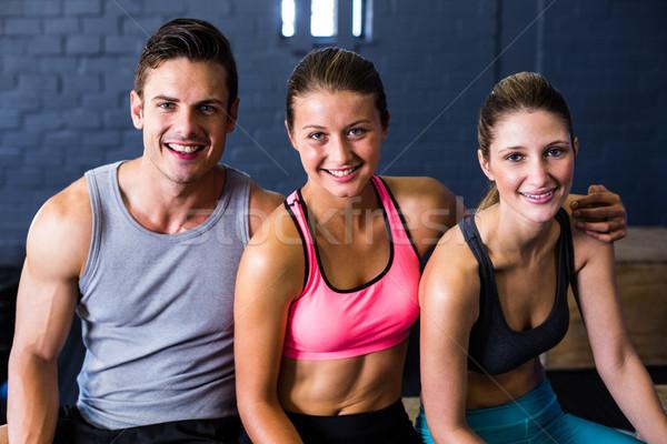 Szczęśliwy kobiet mężczyzna sportowiec fitness studio Zdjęcia stock © wavebreak_media