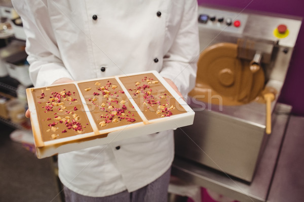 Mid section of worker holding chocolate mould Stock photo © wavebreak_media