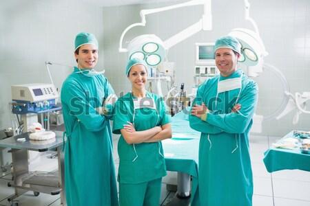 Portrait of a female surgeons standing in operation theater Stock photo © wavebreak_media