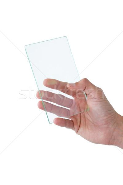 Kéz tart futurisztikus mobiltelefon fehér telefon Stock fotó © wavebreak_media