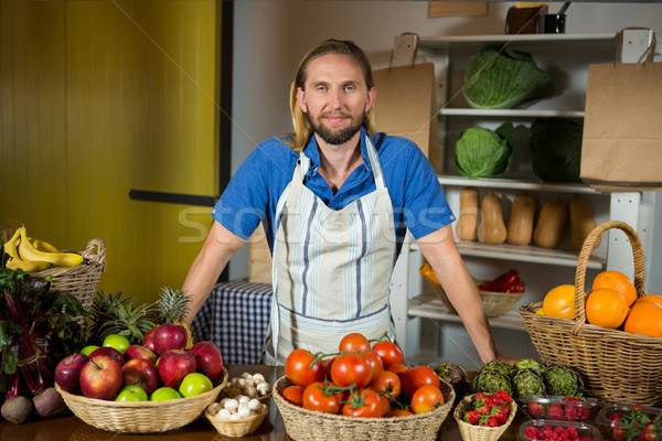 Male staff standing near vegetable counter at organic section in market Stock photo © wavebreak_media