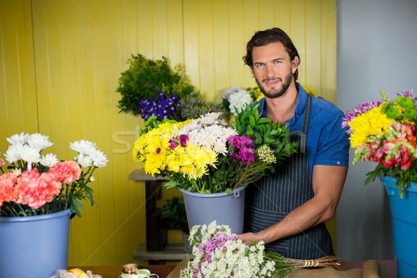 Mutlu çiçekçi kova çiçek portre Stok fotoğraf © wavebreak_media