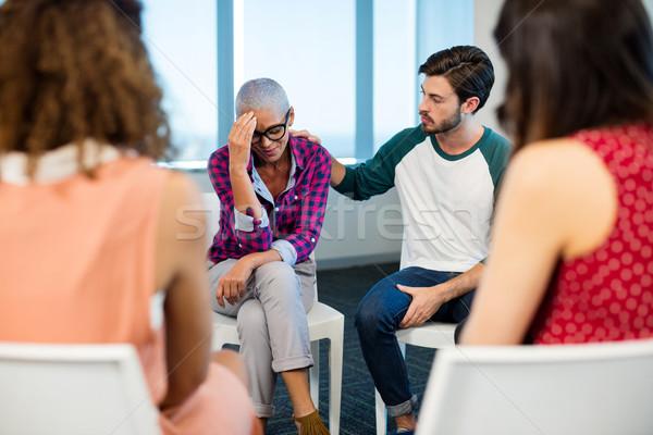 Creative business team consoling upset colleague Stock photo © wavebreak_media