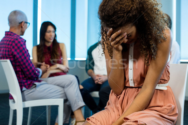 Woman crying while creative business team in background Stock photo © wavebreak_media