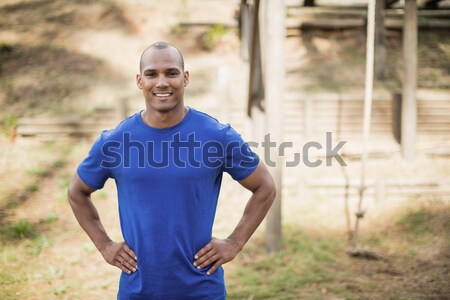 Portrait of fit man standing with hands on hip during obstacle course Stock photo © wavebreak_media
