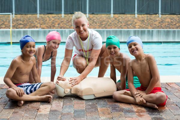 Feliz ninos instructor rescate formación nina Foto stock © wavebreak_media