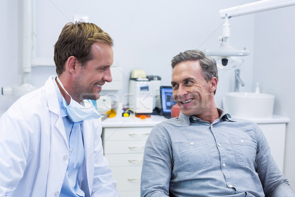 Smiling dentist and patient interacting with each other Stock photo © wavebreak_media
