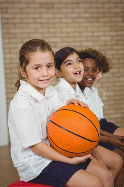 Student holding basketball with fellow players Stock photo © wavebreak_media