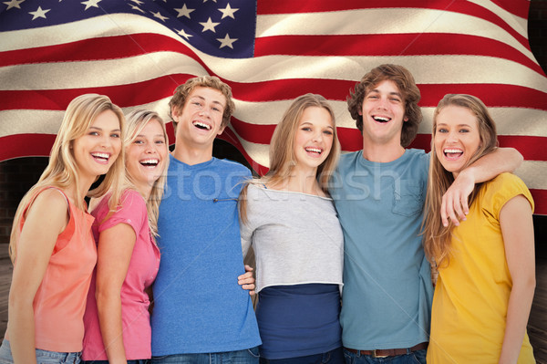 Composite image of a group of friends holding each other and smi Stock photo © wavebreak_media
