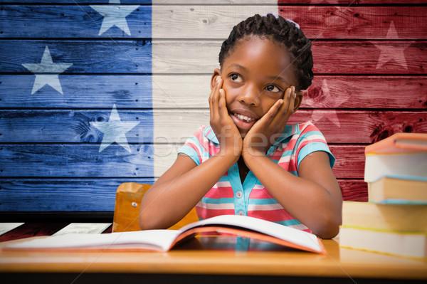 Composite image of pupil sitting at her desk  Stock photo © wavebreak_media