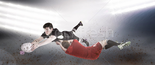 Composite image of a rugby player scoring a try Stock photo © wavebreak_media