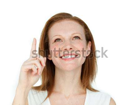 Enthusiastic businesswoman pointing at a copyspace Stock photo © wavebreak_media