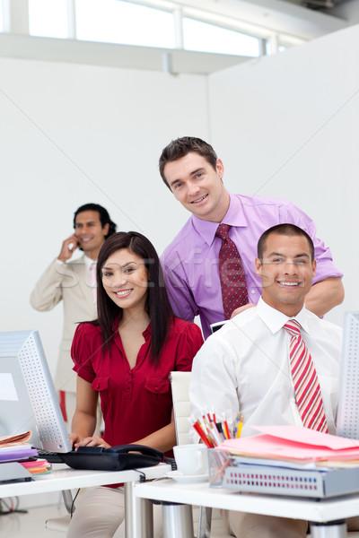 国際ビジネス チーム 笑みを浮かべて カメラ マネージャ 電話 ストックフォト © wavebreak_media