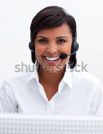 Smiling customer service representative using headset Stock photo © wavebreak_media