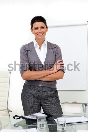 Beautiful businesswoman with folded arms in office Stock photo © wavebreak_media