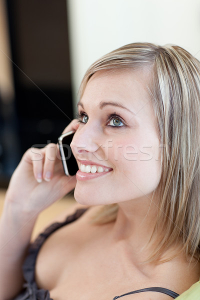 Encantador mulher falante telefone sessão sofá Foto stock © wavebreak_media