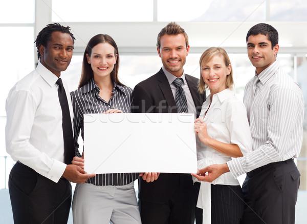Business team holding a blank card Stock photo © wavebreak_media