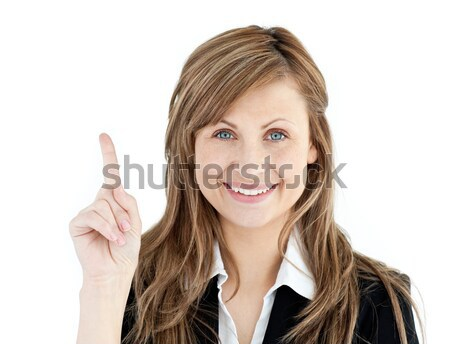 Cheerful businesswoman pointing upward isolated against white background  Stock photo © wavebreak_media