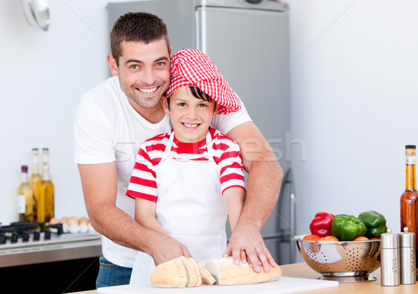 Portrait of a smiling father and his son preparing a meal Stock photo © wavebreak_media