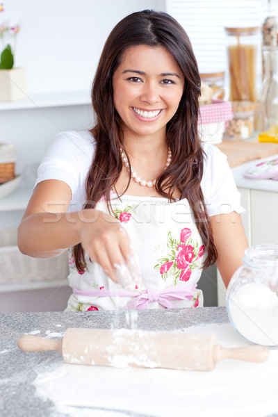 Captivating asian woman baking in her kitchen smiling at the camera Stock photo © wavebreak_media