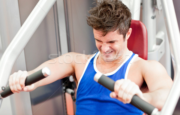 Strong athletic man using a bench press in a fitness center Stock photo © wavebreak_media