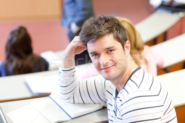Encantado masculino estudante sorridente câmera universidade Foto stock © wavebreak_media