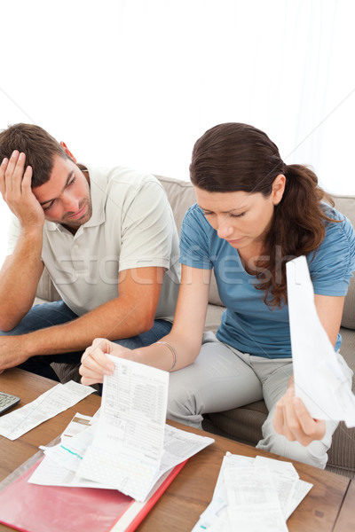 Stressed man and woman looking at their bills in the living room at home Stock photo © wavebreak_media