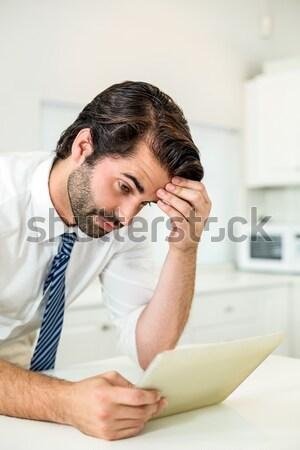 Hombre dolor de cabeza sesión cama compañera mujer Foto stock © wavebreak_media