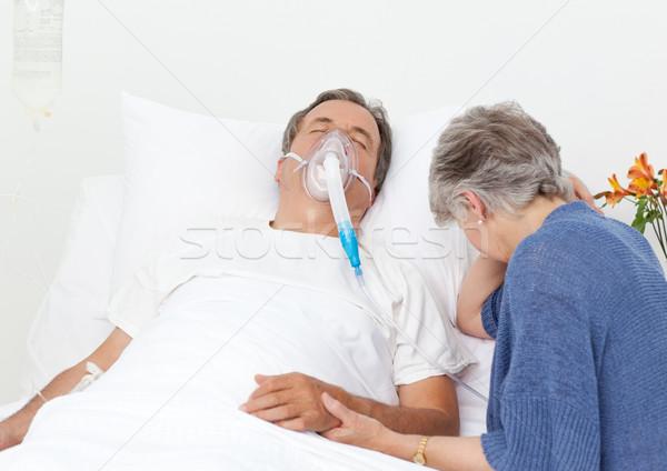 Sad retired woman with her husband in a hospital Stock photo © wavebreak_media